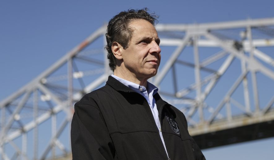 New York Governor Andrew Cuomo attends a media conference on a boat at the Tappan Zee Bridge near Nyack, N.Y., Monday, Oct. 6, 2014. A large crane called the Left Coast Lifter that arrived Monday will assist in the ongoing construction at the bridge. (AP Photo/Seth Wenig)