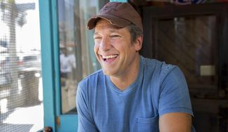 "In this Aug. 21, 2014 photo released by CNN, Mike Rowe appear in a promotional shoot for the series ""Somebody's Gotta Do It,"" in Venice, Calif. Rowe's new travelogue program, ""Somebody's Gotta Do It,"" is a key part of CNN's strategy for the future. It debuts Wednesday, Oct. 8,  at 9 p.m. EDT. (AP Photo/CNN, Jeremy Freeman)"