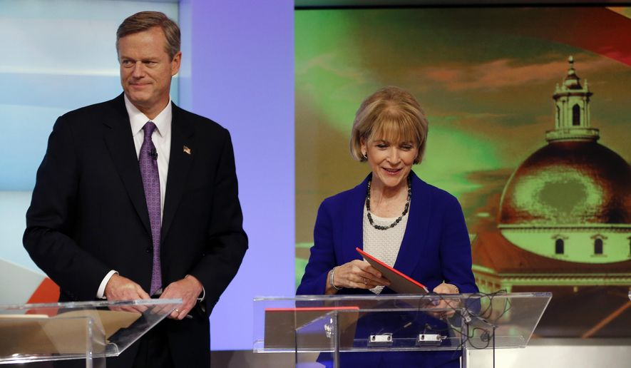 Massachusetts gubernatorial candidates, Republican Charlie Baker and Democrat Martha Coakley prepare at WBZ-TV studios in Boston, Tuesday, Oct. 7, 2014 just prior to the first televised debate amongst all five candidates. Coakley, along with Baker, and independent candidates Evan Falchuk, Scott Lively, and Jeff McCormick are participating in a debate that occurs one month before Election Day, with polls showing Baker and Coakley, the state's attorney general, locked in a dead heat. (AP Photo/Elise Amendola)