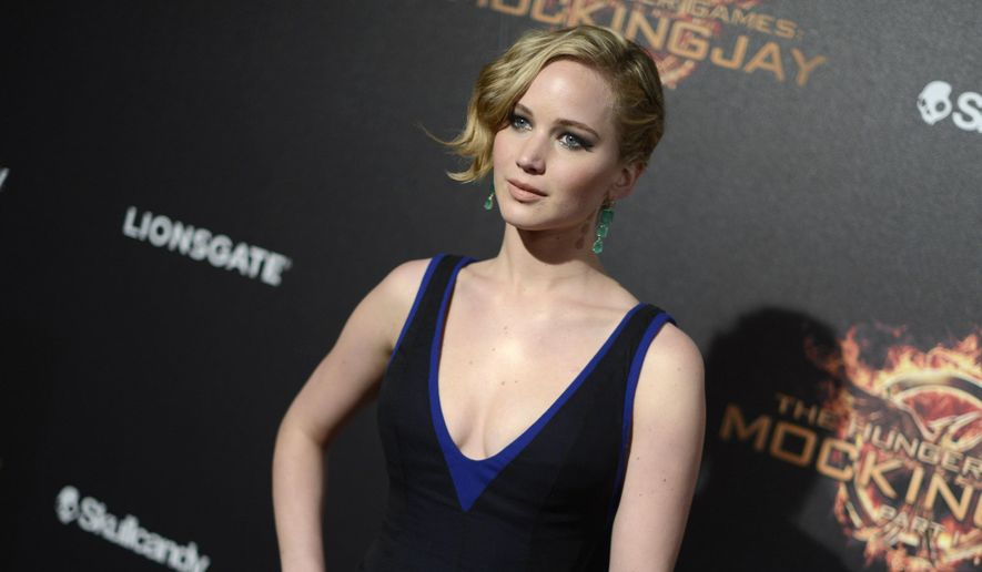 """In this May 17, 2014 file photo, Jennifer Lawrence appears at the """"Hunger Games: Mockingjay - Part 1"""" party at the 67th international film festival, Cannes, southern France. (Photo by Arthur Mola/Invision/AP, File)"""