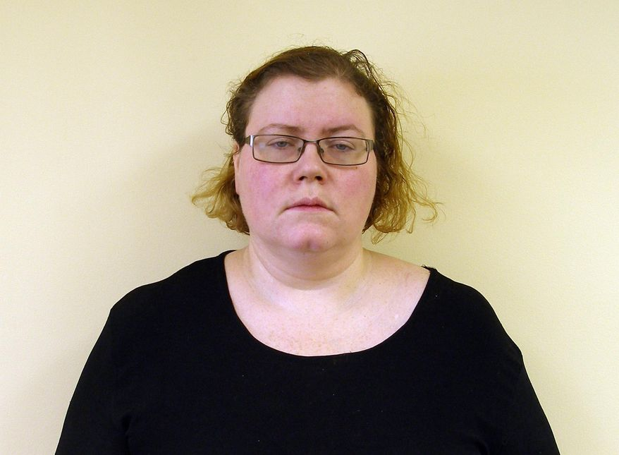 This photo provided by Vermont State Police shows Melissa Robitille. Vermont State Police say Robitille and her boyfriend, Walter Richter III, put alcohol in her disabled son's IV tube, killing the 13-year-old boy. They were charged Tuesday, Oct. 7, 2014 with murder. (AP Photo/Vermont State Police)