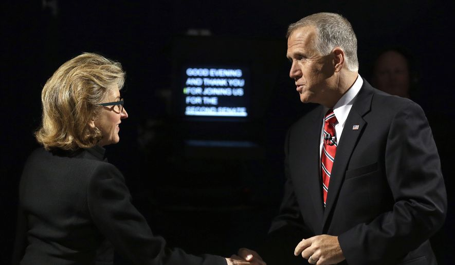 Sen. Kay Hagan, left, D-N.C., and North Carolina Republican Senate candidate Thom Tillis greet prior to a live televised debate at UNC-TV studios in Research Triangle Park, N.C., Tuesday, Oct. 7, 2014. (AP Photo/Gerry Broome, Pool)