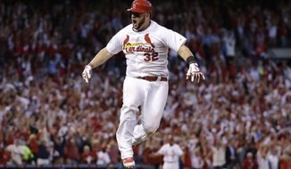 St. Louis Cardinals first baseman Matt Adams celebrates after hitting a three-run home in the seventh inning of Game 4 of baseball's NL Division Series against the Los Angeles Dodgers, Tuesday, Oct. 7, 2014, in St. Louis.(AP Photo/Jeff Roberson)
