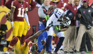 Washington Redskins cornerback David Amerson (39) keeps Seattle Seahawks wide receiver Percy Harvin (11) from the first down, forcing the punt in the fourth quarter at FedExField, Landover, Md., Oct. 6, 2014. (Preston Keres/Special for The Washington Times)