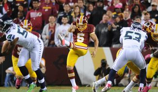 Washington Redskins punter Tress Way (5) booms a punt in the third quarter against the Seattle Seahawks at FedExField, Landover, Md., Oct. 6, 2014. (Preston Keres/Special for The Washington Times)