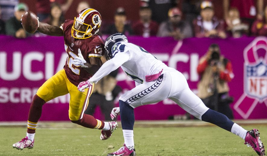 Washington Redskins wide receiver Andre Roberts (12) turns upfield for a first down reception against the Seattle Seahawks at FedExField, Landover, Md., Oct. 6, 2014. (Preston Keres/Special for The Washington Times)