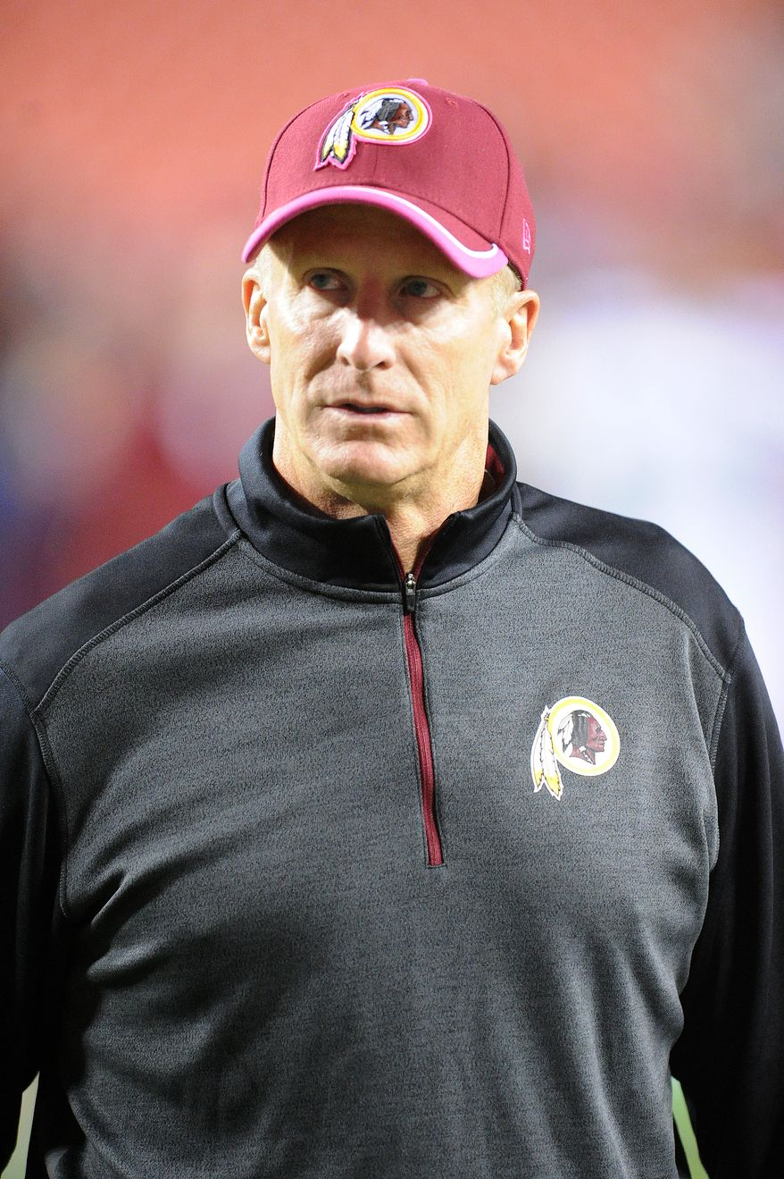 Washington Redskins defensive coordinator Jim Haslett walk off the field after the loss to the Seattle Seahawks at FedExField, Landover, Md., Oct. 6, 2014. (Preston Keres/Special for The Washington Times)