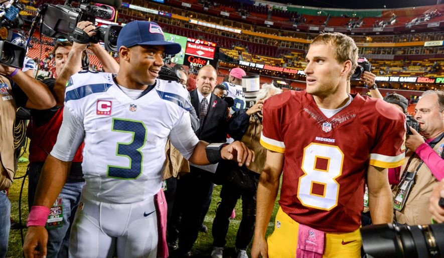 Seattle Seahawks quarterback Russell Wilson (3) and Washington Redskins quarterback Kirk Cousins (8) talk together after the Washington Redskins lose to the Seattle Seahawks 27-17 in Monday Night Football at FedExField, Landover, Md., Monday, October 6, 2014. (Andrew Harnik/The Washington Times)
