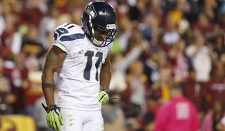 Seattle Seahawks wide receiver Percy Harvin (11) looks down and shakes his head after his touchdown was called back for a penalty during the second half of an NFL football game against the Washington Redskins in Landover, Md., Monday, Oct. 6, 2014. (AP Photo/Alex Brandon)