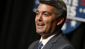Republican challenger U.S. Rep. Cory Gardner makes point during his senatorial debate with incumbent U.S. Sen. Mark Udall, D-Colo., at The Denver Post in Denver on Tuesday, Oct. 7, 2014. (AP Photo/David Zalubowski)