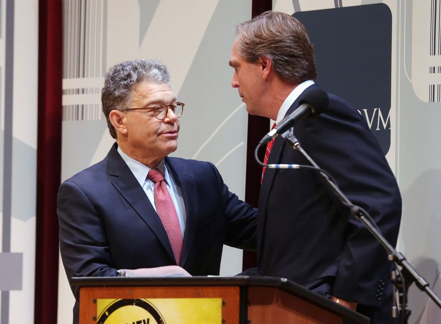 Senate challenger Mike McFadden has accused incumbent Al Franken (left) of failing to stop Minnesota from becoming a recruiting ground for extremists. (Associated Press)