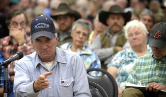 "In this photo taken on Tuesday, Oct. 7, 2014, rancher Dave Dashiell gives a tight-lipped testimony to officials from the Washington Department of Fish and Wildlife about his frustration with wolves that threaten his flocks at meeting in Colville, Wash. ""It's awfully hard to outrun a pack of wolves with a flock of sheep,"" he said. Ranchers in northeastern Washington offered a simple solution to keep wolves from killing their livestock: Pack up the predators and ship them to western Washington. (AP Photo/The Spokesman-Review, Jesse Tinsley)  COEUR D'ALENE PRESS OUT"