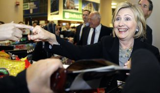 Former U.S. Secretary of State Hillary Rodham Clinton, right, smiles as she talks with supporters at a Barnes & Noble bookstore in Chicago, Wednesday, Oct. 8, 2014. Clinton visited Chicago for two appearances, including a speech to a business group, and to stump for Illinois Gov. Pat Quinn in his bid for re-election. (AP Photo/ Nam Y. Huh)