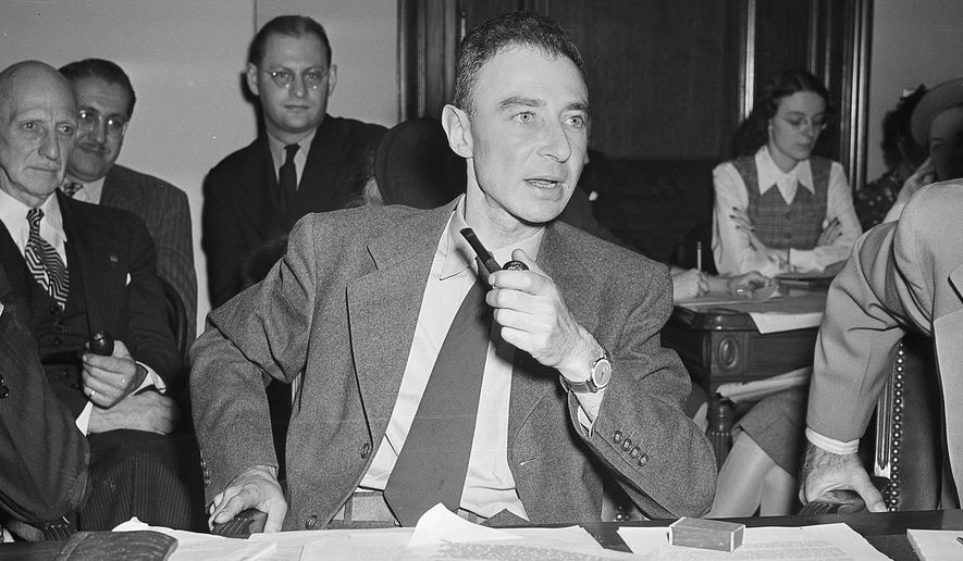FILE-This Oct. 17, 1945 file photo Dr. J. Robert Oppenheimer of the New Mexico laboratories of the atomic bomb making project, testifies before the Senate Military Affairs Committee in Washington.  The U.S. Department of Energy has declassified documents related to the Cold War hearing on Oppenheimer who directed the Manhattan Project and was later accused of having communist sympathies. The department last week released transcripts of the 1950s hearings on  Oppenheimer's security clearance, providing more insight into the previously secret world that surrounded development of the atomic bomb. (AP Photo,File)