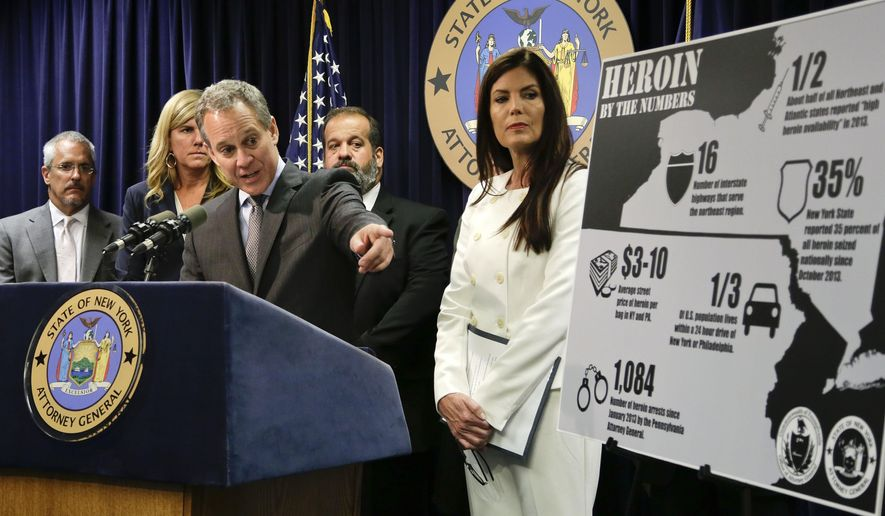 New York state attorney general Eric Schneiderman, center, speaks about a multistate task force formed to address the Northeast heroin crisis during a news conference accompanied by Pennsylvania state attorney general Kathleen Kane, right, Wednesday, Oct. 8, 2014, in New York. Authorities in four Northeast states have agreed to collaborate in investigations of heroin trafficking that often cross state lines. The coalition so far includes New York, Pennsylvania, New Jersey and Massachusetts, with other states expected to join. (AP Photo/Julie Jacobson)