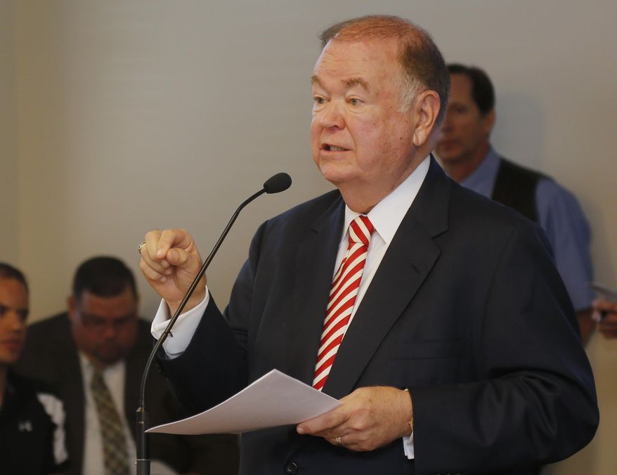 University of Oklahoma President David Boren speaks to a  joint hearing of the Oklahoma House committees on public safety and higher education in Oklahoma City, Wednesday, Oct. 8, 2014. Boren said that allowing more students and faculty members at colleges and universities to carry guns on campus would be a serious mistake and jeopardize the safety of the public. (AP Photo/Sue Ogrocki)