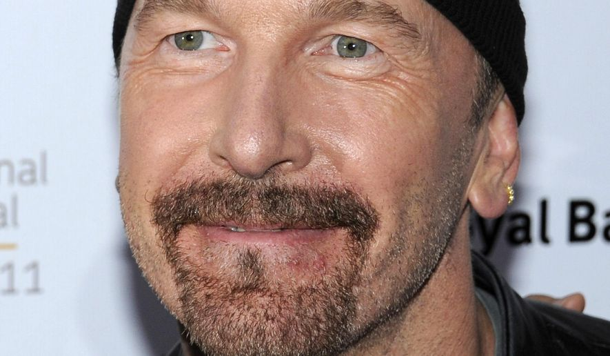 FILE - In this Sept. 8, 2011 file photo, U2 guitarist The Edge, whose given name is David Evans, attends an opening at the Toronto International Film Festival in Toronto. The California Coastal Commission has postponed on Wednesday, Oct. 8, 2014 a vote on a long-planned proposal by U2 guitarist The Edge and others to build five mansions in the mountains above Malibu. (AP Photo/Evan Agostini, File)