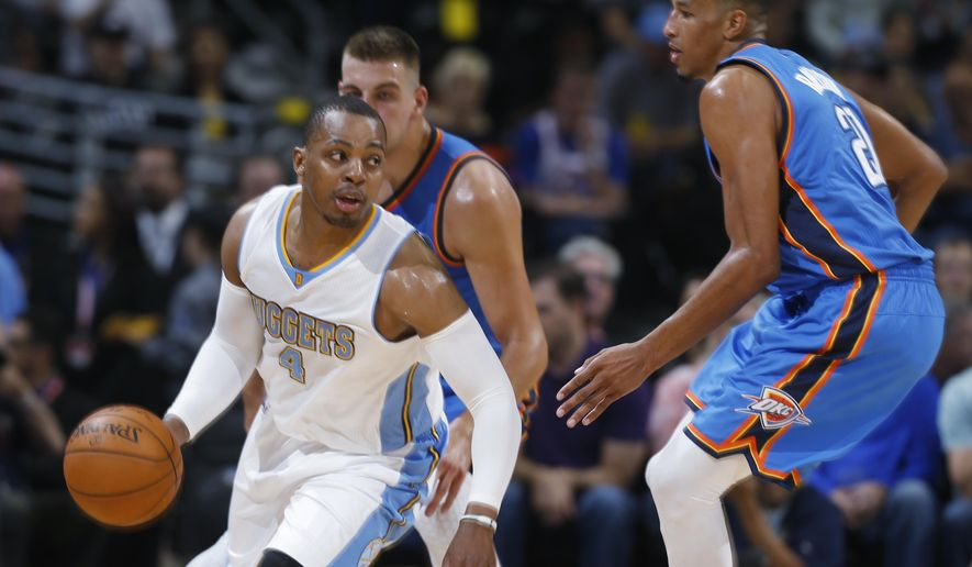 Denver Nuggets guard Randy Foye, front left, picks up a loose ball as Oklahoma City Thunder forward Mitch McGary, back left, and guard Andre Roberson cover in the first quarter of an NBA exhibition basketball game in Denver, Wednesday, Oct. 8, 2014. (AP Photo/David Zalubowski)