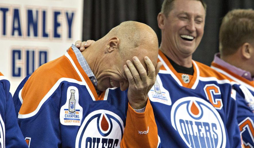 Former Edmonton Oilers' Wayne Gretzky, right, laughs as Mark Messier tells a story during the 1984 Stanley Cup NHL hockey reunion media availability in Edmonton, Alberta, Wednesday, Oct. 8, 2014. (AP Photo/The Canadian Press, Jason Franson)