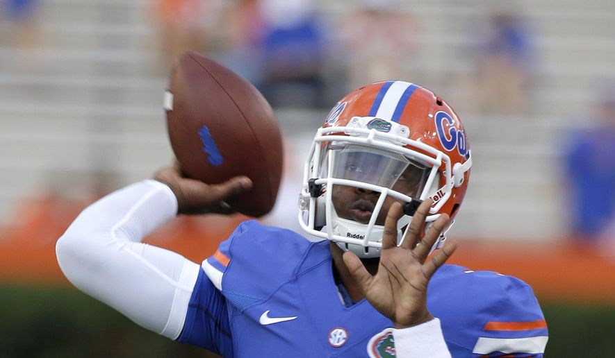 In this Sept. 13, 2014, file photo, Florida freshman quarterback Treon Harris (3) warms up prior to an NCAA college football game against Kentucky in Gainesville, Fla. (AP Photo/John Raoux, File)