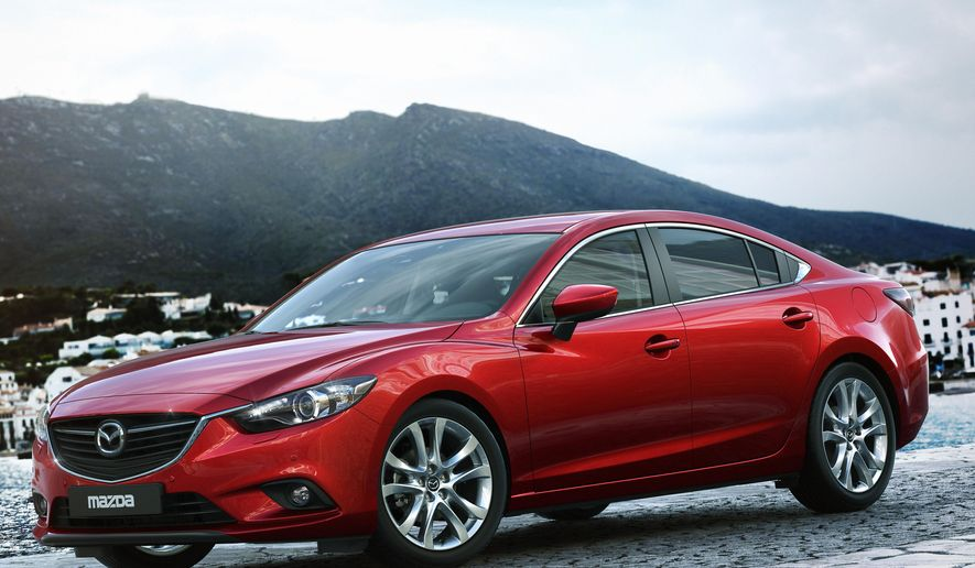 This undated product image provided by Mazda shows the 2015 Mazda6. Gas mileage for new cars and trucks in the U.S. averaged a record 24.1 miles per gallon last year, but the rate of improvement is slowing. Mazda led all automakers with an average of 28.1 mpg. (AP Photo/Mazada)