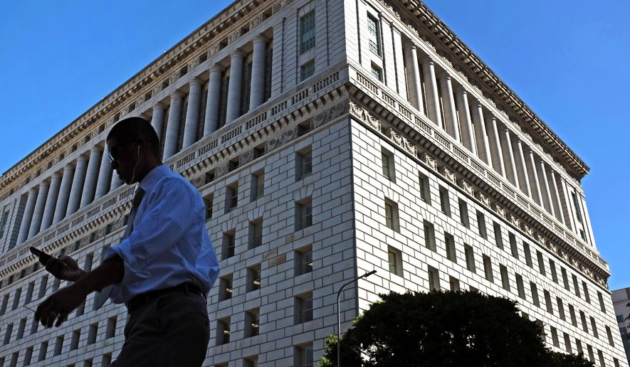 This Oct. 6, 2014 photo a pedestrian walks past the Hall of Justice in downtown Los Angeles. The ornate Los Angeles County Hall of Justice, where Charles Manson and Sirhan Sirhan were tried, has been dedicated in a ceremony on Wednesday, Oct. 8, 2014 marking its reopening after a two-decade closure and a $231 million renovation. (AP Photo/Richard Vogel)