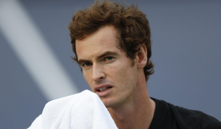 Andy Murray of Britain reacts after getting a point during a match against Jerzy Janowicz of Poland at their men's singles second round match at the Shanghai Masters Tennis Tournament in Shanghai, China, Wednesday, Oct. 8, 2014.  (AP Photo/Vincent Thian)