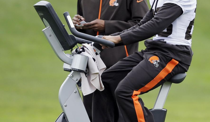 Cleveland Browns cornerback Joe Haden rides a stationary bike during practice at the NFL football team's facility in Berea, Ohio Wednesday, Oct. 8, 2014. Haden's injured hip could force Browns coach Mike Pettine to make some adjustments to his shaky secondary this Sunday against Pittsburgh. (AP Photo/Mark Duncan)