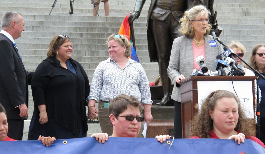 Nichols Bleckley and Colleen Condon, both center, want a federal court in South Carolina to issue a preliminary injunction preventing the state from enforcing its gay marriage ban. (AP Photo/Jeffrey Collins)