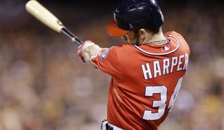 Washington Nationals Bryce Harper hits a solo home run in the seventh inning against the San Francisco Giants during Game 4 of baseball's NL Division Series in San Francisco, Tuesday, Oct. 7, 2014.  (AP Photo/Ben Margot)