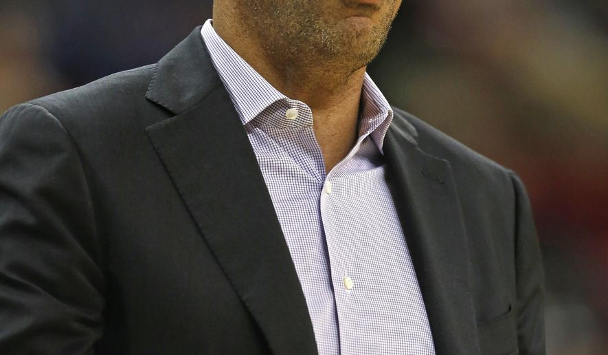 Milwaukee Bucks head coach Jason Kidd argues a call with officials during the first half of an NBA preseason basketball game against the Memphis Grizzlies, Wednesday, Oct. 8, 2014, in Green Bay, Wis. (AP Photo/Matt Ludtke)