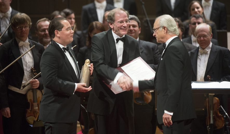 Andreas Grossbauer, left, of the Vienna Philharmonic Orchestra, and his precursor as chairman and present archivist, Clemens Hellsberg, center, shakes hands with Swedish King Carl XVI Gustaf at the Concert Hall in Stockholm, Sweden, Wednesday Oct. 8, 2014, during a ceremony in memory of legendary soprano Birgit Nilsson. The Vienna Philharmonic Orchestra has been awarded the Birgit Nilsson Dollars 1 million Prize for 2014. (AP Photo/TT News Agency, Fredrik Sandberg) SWEDEN OUT