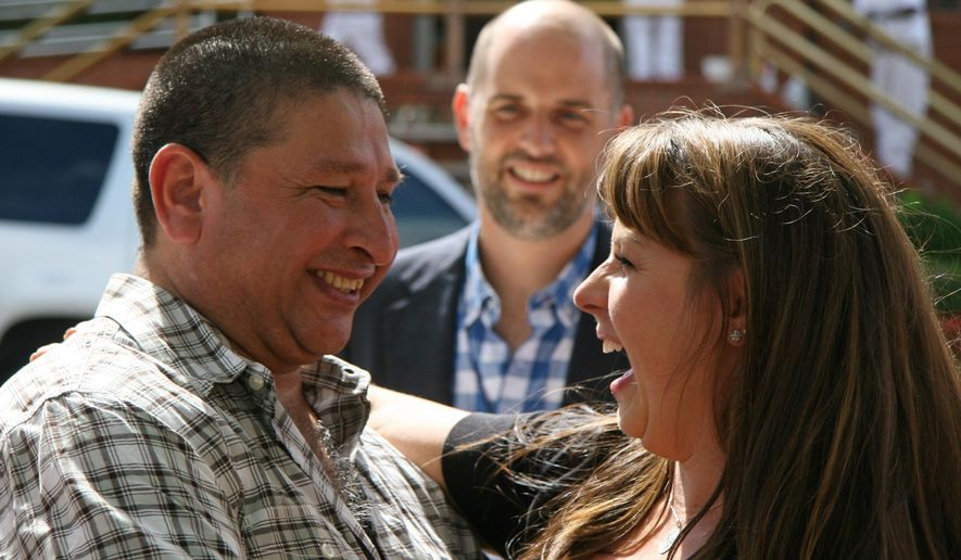Former Texas death row inmate Manuel Velez, 49, is greeted by his attorneys Jaclyn Brown, of Denver, right, and Brian Stull, of Durham, N.C. as he leaves the Texas Department of Criminal Justice Huntsville Unit on Wednesday, Oct. 8, 2014. An appeals court threw out his conviction because of faulty testimony and deficient legal help at his trial, and the 49-year-old Velez in August accepted a plea bargain to a lesser charge, allowing him to be paroled.  (AP Photo/Michael Graczyk)
