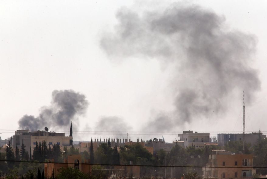 Smoke rises after strikes in Kobani, Syria as fighting intensifies between Syrian Kurds and the militants of Islamic State group, as seen from Mursitpinar on the outskirts of Suruc, at the Turkey-Syria border,  Wednesday, Oct. 8, 2014. Kobani has been under the onslaught of the Islamic State group since mid-September when the militants' launched their offensive in the area, capturing several Kurdish villages around the town and bringing Syria's civil war yet again to Turkey's doorstep.  (AP Photo/Lefteris Pitarakis)