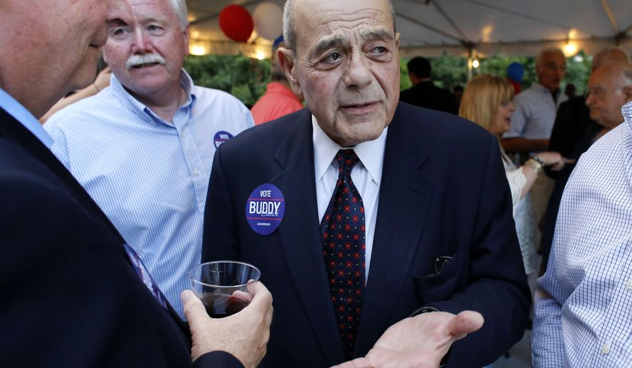 FILE - In this Sept. 10, 2014, file photo, former Providence Mayor Buddy Cianci, center, speaks with supporters, including assistant city solicitor Kevin McHugh, holding wine glass at left, during a fundraising event in Providence, R.I.  Cianci accepted campaign contributions from dozens of city employees, including a $125 contribution from McHugh, in his comeback bid for City Hall despite pledging not to, according to campaign finance reports filed Tuesday. (AP Photo/Steven Senne, File)