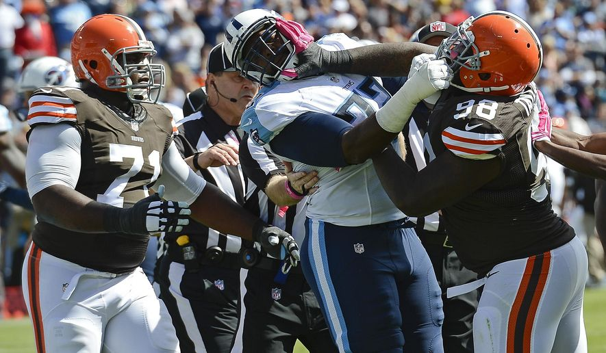 Cleveland Browns defensive end Phil Taylor (98) scuffles with Tennessee Titans tackle Michael Oher (72) in the second quarter of an NFL football game Sunday, Oct. 5, 2014, in Nashville, Tenn. (AP Photo/Mark Zaleski)