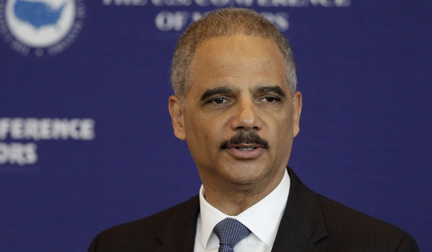 U.S. Attorney General Eric Holder speaks to a meeting of the U.S. Conference of Mayors at the Clinton Presidential Library in Little Rock, Ark., on Oct. 8, 2014. (Associated Press) **FILE**