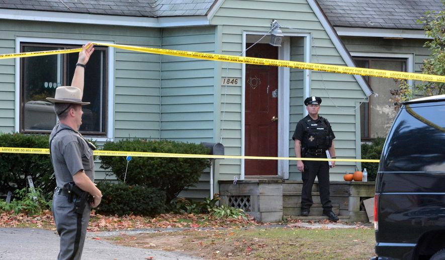 Police secure the scene of a quadruple homicide at 1846 Western Avenue in Guilderland, N.Y., Wednesday, Oct. 8, 2014. Police in the Albany suburb tell local media outlets that four people were killed, but they haven't released any other details. (AP Photo/The Daily Gazette, Patrick Dodson)  TROY, SCHENECTADY; SARATOGA SPRINGS; ALBANY AND AMSTERDAM OUT