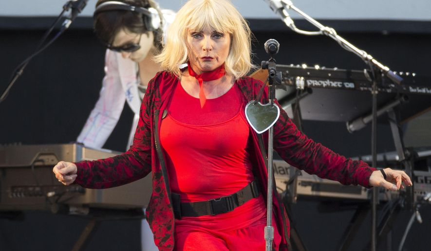 FILE - In this Aug. 16, 2014 file photo, Blondie, also known as Debbie Harry, performs on stage during V Festival 2014 at Hylands Park in Chelmsford, Essex, in England. Harry will perform at the 34th annual John Lennon charity tribute concert in New York City in December. (Photo by Joel Ryan/Invision/AP, File)