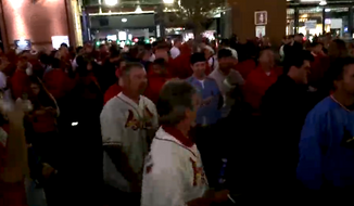 Racial tensions simmered outside Busch Stadium in St. Louis Monday night as Cardinals fans clashed with Ferguson protesters, who were there demonstrating for slain teen, Michael Brown. (Argus Streaming News)