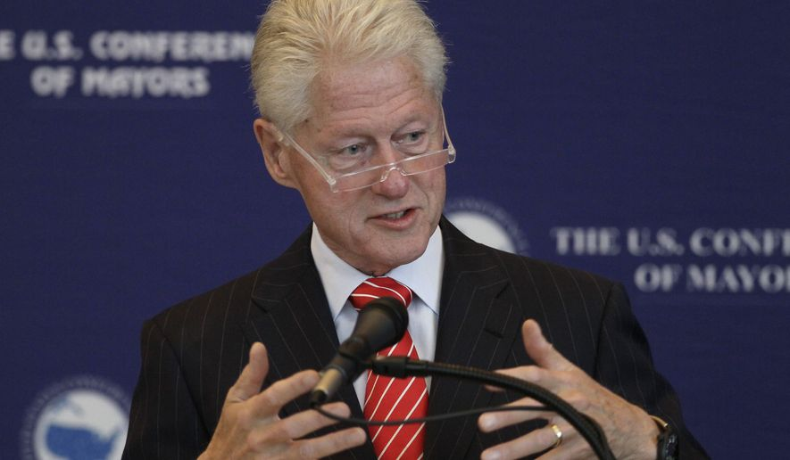 Former President Bill Clinton speaks to a meeting of the U.S. Conference of Mayors at the Clinton Presidential Library in Little Rock, Ark., Wednesday, Oct. 8, 2014. (AP Photo/Danny Johnston)