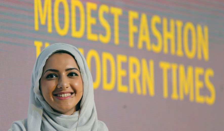 "In this Oct. 5, 2014 photo, Summer Albarcha, owner of photo-sharing Instagram account ""Hipster Hijabis"", talks during a Fashion Forward session in Dubai, United Arab Emirates. By fusing both their sense of fashion with their faith, Muslim women are reinterpreting traditional notions of what it means to dress conservatively. Some have also pioneered businesses around this growing demand, finding unexpected supporters among some mainstream brands, as well as conservative Christian and Orthodox Jewish women. (AP Photo/Kamran Jebreili)"