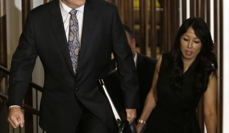Terry and Kim Pegula arrive for a meeting of NFL owners and executives in New York, Wednesday, Oct. 8, 2014. NFL owners have unanimously approved the sale of the Buffalo Bills to Terry and Kim Pegula.  The husband and wife already own the NHL's Buffalo Sabres.   (AP Photo/Seth Wenig)