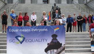 South Carolina Equality Board Chairman Jeff Ayers, speaks at a Statehouse rally on Wednesday, Oct. 8, 2014, in Columbia, S.C. Supporters of gay marriage held a rally at the capitol the same day a Charleston County Probate judge approved an application for a same-sex marriage license. (AP Photo/Jeffrey Collins)