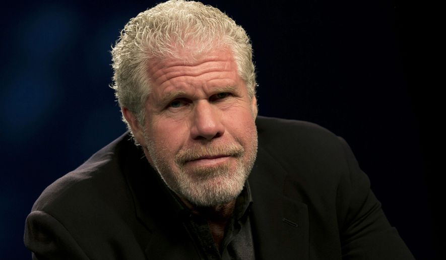 "In this Sept. 30, 2014 photo, actor Ron Perlman poses for photos before an interview, in New York. Perlman, 64, has been kicking around Hollywood for 30-plus years, racking up more than 200 credits in theater, film, TV and voice work thanks to his signature growly demeanor. Now, he's the proud owner of a revealing memoir, ""Easy Street (The Hard Way),"" co-written by Michael Largo with a foreword by one of his enablers, filmmaker Guillermo del Toro.  (AP Photo/Richard Drew)"