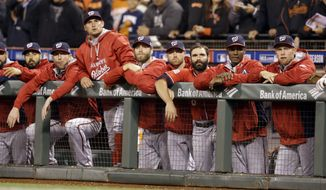 The Washington Nationals watch in the final minutes of the ninth inning against the San Francisco Giants during Game 4 of baseball's NL Division Series in San Francisco, Tuesday, Oct. 7, 2014. The Giants beat the Nationals 3-2 to advance. (AP Photo/Ben Margot)