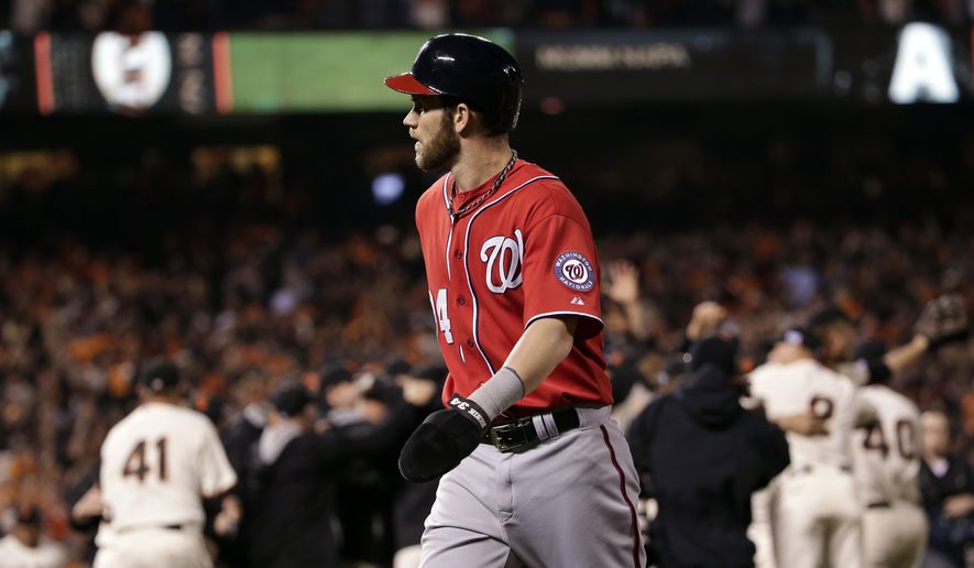 Washington Nationals right fielder Bryce Harper walks off the field after Game 4 of baseball's NL Division Series in San Francisco, Tuesday, Oct. 7, 2014. The Giants beat the Nationals 3-2 to advance to the next round. (AP Photo/Marcio Jose Sanchez)