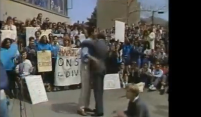 """In this screenshot from a video, Barack Obama, left, embraces law professor Derrick Bell, creator of race-based """"critical legal theory,"""" at a 1990 meeting of black students at Harvard Law School."""