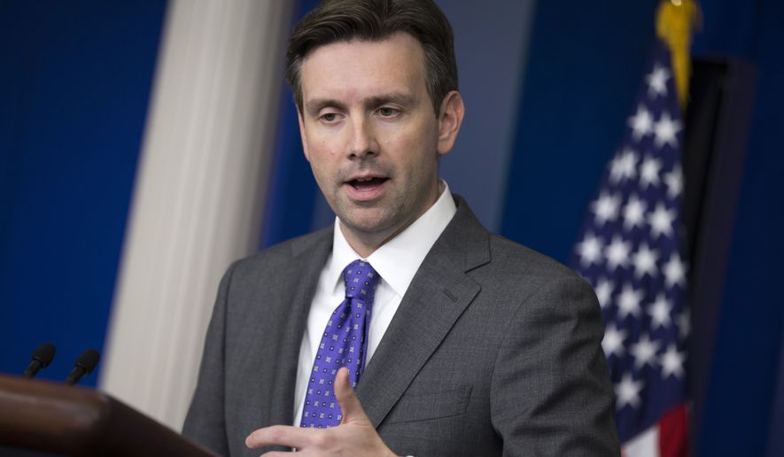 White House press secretary Josh Earnest gestures as he answers a question during the daily press briefing at the White House in Washington, Wednesday, Oct. 8, 2014. (Associated Press)