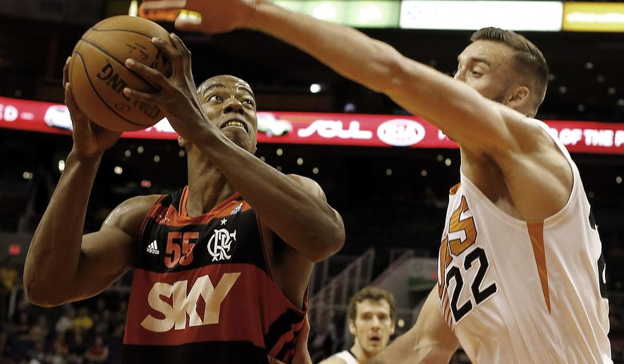 Flamengo center Derrick Caracter (55), left, drives against Phoenix Suns center Miles Plumlee (22) in the first quarter during an NBA preseason basketball game, Wednesday, Oct. 8, 2014, in Phoenix. (AP Photo/Rick Scuteri)